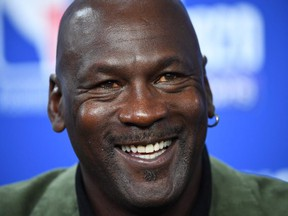 In this file photo taken on January 24, 2020 former NBA star and owner of Charlotte Hornets team Michael Jordan looks on as he addresses a press conference ahead of the NBA basketball match between Milwaukee Bucks and Charlotte Hornets at The AccorHotels Arena in Paris.