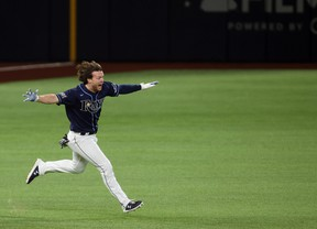 Tampa Bay Rays right fielder Brett Phillips (14) celebrates after driving in the winning run against the Los Angeles Dodgers during the ninth inning of game four of the 2020 World Series at Globe Life Field.