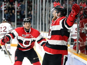 Ottawa's Tye Felhaber (right) is congratulated by teammate Sasha Chmelevski after scoring against Guelph May 2, 2019 at TD Place in Ottawa.