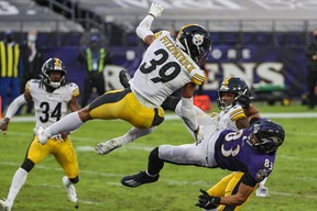 Steelers' safety Minkah Fitzpatrick #39 and cornerback Justin Layne #31 break up a pass intended for Ravens  wide receiver Willie Snead on the last play of the game during Pittsburgh's 28-24, win at Baltimore on Sunday.