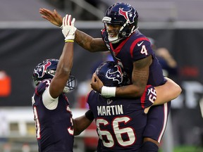 Texans quarterback Deshaun Watson isn't happy with his team's management after it didn't give Eric Bieniemy an interview for their head coaching job.