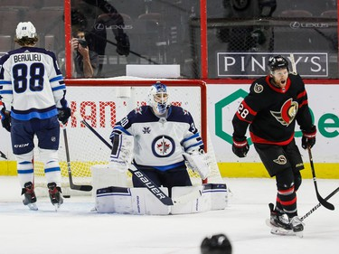 Senators right-winger Connor Brown (28) celebrates a goal by teammate Alex Galchenyuk (not seen) against the Jets in the second period on Tuesday night.