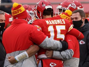Quarterback Patrick Mahomes of the Kansas City Chiefs is assisted off the field after an injury from a sack that would remove Mahomes in the third quarter of the AFC Divisional Playoff game against the Cleveland Browns at Arrowhead Stadium on Jan. 17, 2021.