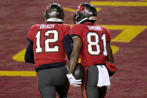 Quarterback Tom Brady and wide receiver Antonio Brown of the Tampa Bay Buccaneers celebrate after connecting for a  touchdown pass  in the NFC wild card playoff game.