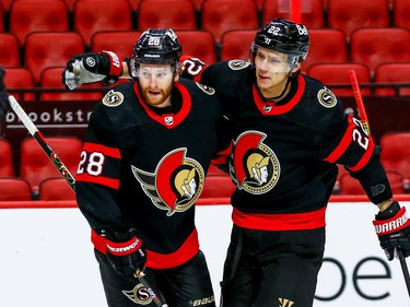 Senators defenceman Nikita Zaitsev (22) congratulates right-winger Connor Brown after his goal in the opening minute of the game.