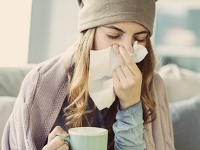 Young woman suffering from cold.
