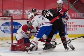 Senators winger Brady Tkachuk (7) looks for a loose puck in front of Montreal Canadiens goalie Carey Price during the second period on Tuesday night at the Canadian Tire Centre. Tkachuk had two goals in the game.