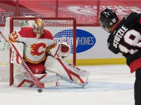 Calgary Flames goalie David Rittich (33) makes a save on a shot by Ottawa Senators left wing Tim Stutzle (18) in the second period at the Canadian Tire Centre.