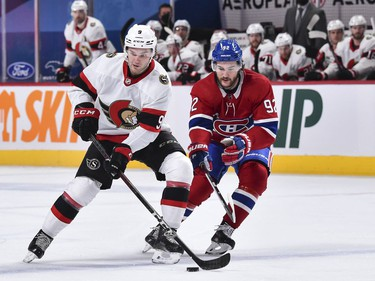 Josh Norris of the Senators skates with the puck against Jonathan Drouin of the Canadiens during the first period.