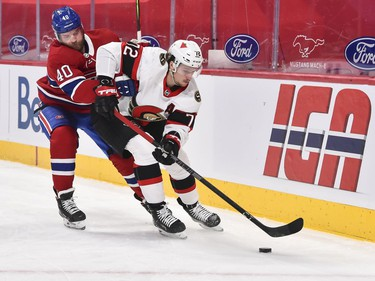 Joel Armia of the Canadiens challenges Thomas Chabot of the Senators during the second period.