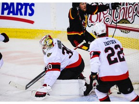 CALGARY, AB - MARCH 4: Brett Ritchie #24 of the Calgary Flames celebrates after scoring against Matt Murray #30 of the Ottawa Senators during an NHL game at Scotiabank Saddledome on March 4, 2021 in Calgary, Alberta, Canada.