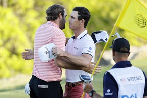 Billy Horschel (right) shakes hands with fellow American Scottie Scheffler after winning 2&1 in the final round of the World Golf Championships-Dell Technologies Match Play at Austin Country Club on Sunday.