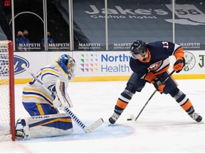 Mathew Barzal of the New York Islanders scores against Buffalo Sabres goaltender Carter Hutton using a between-the-legs shot on March 6, 2021.