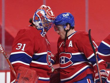Canadiens goalie Carey Price (31) receives a friendly head butt from teammate Brendan Gallagher after Tuesday's win over the Senators in Montreal.