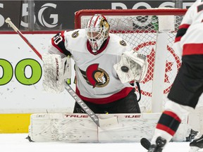 Goalie Matt Murray of the Ottawa Senators makes a glove save against the Vancouver Canucks during the third period of NHL action at Rogers Arena on April 22, 2021 in Vancouver, Canada.