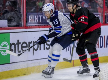 Ottawa Senators defenceman Artem Zub (right) checks Winnipeg Jets centre Pierre-Luc Dubois during second period NHL action at the Canadian Tire Centre.