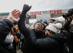 People react after the verdict in the trial of former Minneapolis police officer Derek Chauvin, found guilty of the death of George Floyd, at George Floyd Square in Minneapolis, Minn., April 20, 2021.