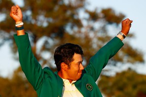 Hideki Matsuyama of Japan celebrates during the green jacket ceremony after winning the Masters at Augusta National Golf Club on April 11, 2021 in Augusta, Ga.