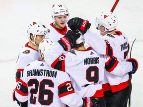 Some of the talented young Ottawa Senators — Erik Brannstrom, Tim Stuetzle (18), Drake Batherson (19), Brady Tkachuk (7) and Josh Norris — celebrate after a Norris goal against Calgary on Monday.