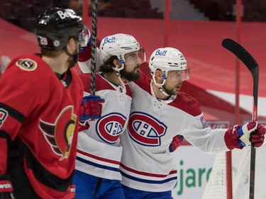 Montreal Canadiens center Phillip Danault (24) celebrates with left wing Thomas Tatar (90) as Ottawa Senators right wing Connor Brown (28) skates past in the first period at the Canadian Tire Centre.