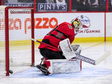 Ottawa Senators goaltender Matt Murray (30) gets some help from his goal post against the Winnipeg Jets during the second period.