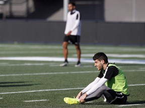 Drew Beckie stretches after Ottawa Fury FC practice at TD Place in 2015.
