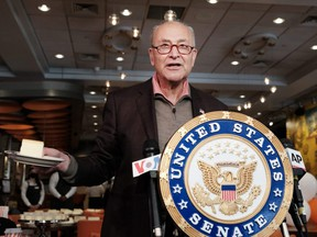 U.S. Senate Majority Leader Chuck Schumer (D-NY) attends a ribbon cutting and the official re-opening of Junior's restaurant in Times Square which had been closed during the pandemic, on Thursday, May 6, 2021 in New York City.