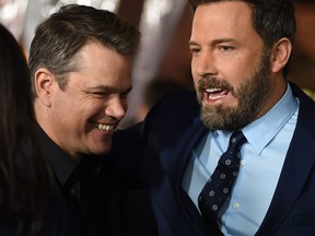 "Actors Matt Damon, left, and Ben Affleck arrive for the world premiere of Warner Bros. ""Live By Night,"" Jan. 9, 2017 at the TCL Chinese Theater in Hollywood, Calif."