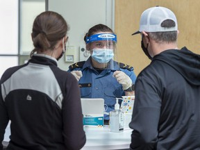 Sailor Second Class Hannah Angel directs residents as they arrive for asymptomatic COVID-19 testing at the Canada Games Centre in Halifax on Wednesday, April 28, 2021.