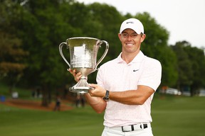 Rory McIlroy poses with the trophy after winning the Wells Fargo Championship at Quail Hollow Club on Sunday in Charlotte, N.C.