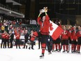 Picture of Brandt Clarke holding up championship trophy at world under 18 championships.