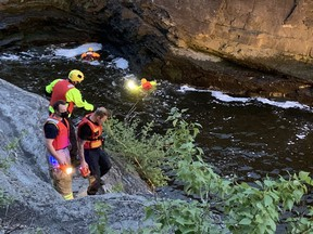 Ottawa- Police and firefighters converged on Hog's Back Bridge over the Rideau River at Hog's Back Falls on the evening of Saturday May 15,2021. Members of a water rescue team swam in to the Rideau River and searched just downstream from the roaring falls.