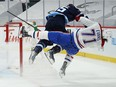 The Jets' Mark Scheifele flattens Jake Evans after he scored an empty-net goal in last minute of the Canadiens' 5-3 win in Game 1 of North Division final Wednesday night in Winnipeg.