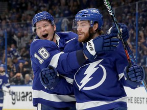 Brayden Point of the Tampa Bay Lightning celebrates with Ondrej Palat (18) after scoring a goal during the first period in Game 2 of the Stanley Cup semifinals at Amalie Arena on June 15, 2021 in Tampa, Fla.