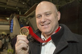 Ottawa 67's head coach André Tourigny shows off the gold he won at the 2020 world juniors as Team Canada assistant coach.
