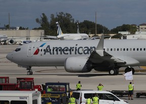American Airlines jet pulls away from its gate at Miami International Airport.