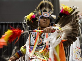 Members of the Heavenly Skies Society perform during Indigenous Peoples Day celebrations at Edmonton City Centre, June 20, 2019.