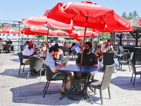 Patrons enjoy an outdoor patio at Turtle Jacks' as Port Carling welcomes tourist back to the area after the Muskoka area enters stage two of lifting the COVID-19 lockdown on Thursday, June 18, 2020.
