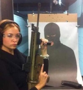 Canadian socialite Jasmine Hartin poses with one of her guns.
