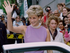 Diana, Princess of Wales, waves to the public as she leaves the Victor Chang Cardiac Research Institute in Sydney on Nov. 1, 1996.