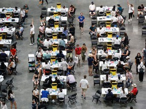 File photo/ People receive a dose of the COVID-19 vaccine at a mass vaccination clinic at Scotiabank Arena in Toronto on Sunday, June 27, 2021.