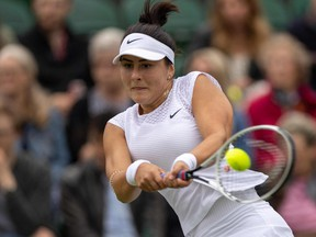 Canada's Bianca Andreescu returns against France's Alize Cornet during their women's singles first round match on the third day of the 2021 Wimbledon Championships at The All England Tennis Club in Wimbledon, southwest London, on June 30, 2021.