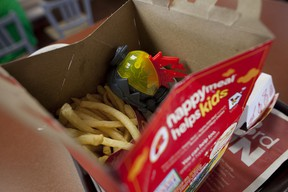 Two McDonald's employees were charged and arrested in Maine after the prescription drugs of one of them fell into a child's Happy Meal box.