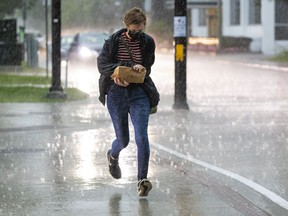 Running for cover from the heavy rainfall was a common fate for people in downtown Ottawa on Tuesday.
