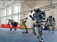 Spot, Handle and Atlas robots dance during a year-end video by the robotics company Boston Dynamics in a screen grab from a Dec. 29, 2020 social media post.