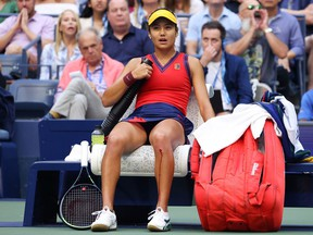 Emma Raducanu takes an injury timeout after cutting her knee while sliding for a ball as she plays against Leylah Annie Fernandez of Canada in the U.S. Open final on Sept. 11, 2021.