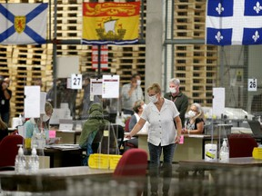 """Special ballots from national and international Canadian Forces and incarcerated electors were being counted in the """"counting cage"""" at Elections Canada Distribution Centre Monday evening."""