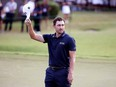 Patrick Cantlay celebrates on the 18th green after winning the TOUR Championship at East Lake Golf Club on September 5, 2021 in Atlanta.