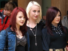 British actresses Meghan, left, and Kathryn Prescott, right, with Lily Loveless, centre, arrive in London's Leicester Square, on June 10, 2009 to attend the British Premiere of The Hangover.