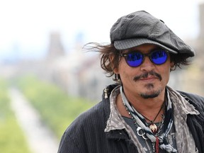 """US actor Johnny Depp poses during the photocall of the film """"Minamata"""" at the BCN Film Fest on April 16, 2021 in Barcelona."""